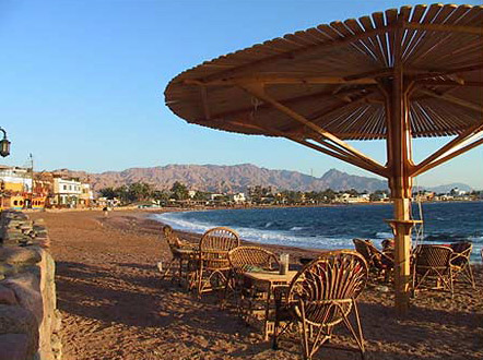 Dahab is the Arabic word for gold - have a look at the colour of the sand around