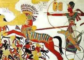 Ramesses II in battle on his chariot, wearing armor.