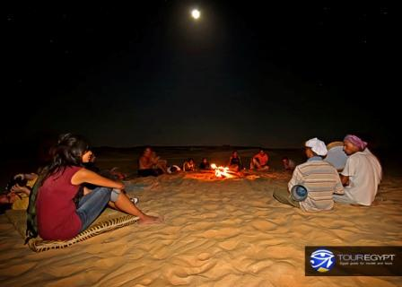 Photo of a group enjoying a campfire in the Egyptian desert