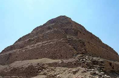 Vew of the Step Pyramid of Djoser at Saqqara in Egypt, a crumbling corner