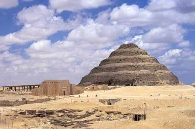 A nice overall view of the Djoser Step Pyramid Complex including the pyramid and entrance of the enclosure wall