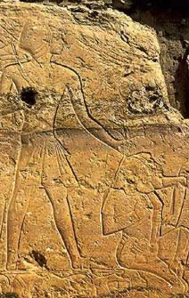 Ramesses II grasps the hair of a kneeling Syrian captive