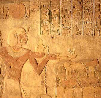 Ramesses II making offerings in a wall relief at Beit el-Wali