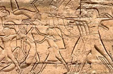 Archers of Ramesses III's army shoot the Libyan enemies, whose fallen bodies are shown sprawled on the ground