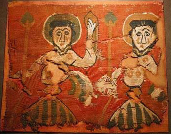 A Coptic Textile dating from between the 6th and 7th century AD, apparently depicting two (dancing?) saints on Wool, with some lacunae