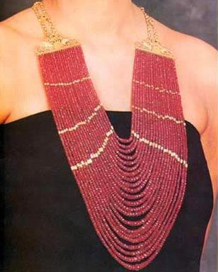 An Azza Fahmy creation of gold and precious stones in red