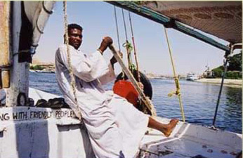 A felucca capttain operating his felucca on the Nile at Cairo