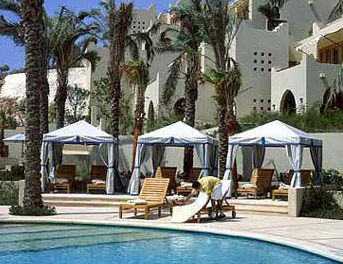 Covered lounge chairs at the main pool at the Four Seasons in Sharm