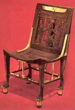 From The Tomb Of Tutankhamun, A Carved Chair With The God Heh, Made Of