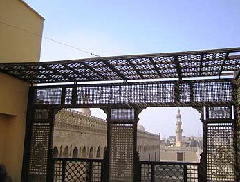 Mashrabeya screens use wood patterns to spell out important Islamic phrases such as