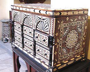 A chest for valuables with intricate Arabic designs