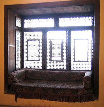 A sofa with Mashrabeya screen in the library of the house
