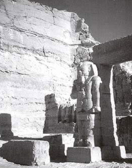 An image of one of the colossal statues of Ramesses II in the courtyard of the temple