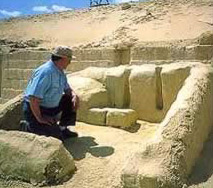 An Egyptologist examines the ruins of the Giza Pyramid workers