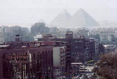 The Pyramids of Giza seen from the city