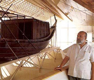 Ahmed Youssef with the resorted boat of Khufu in its museum at Giza