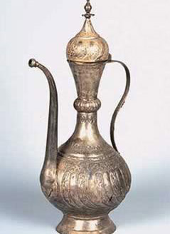 Ewer ornamented with geometrical designs in relief, it was used during the Mass service at the Holy Virgin Church. This item is now in the Coptic Museum.