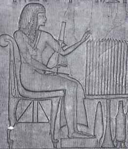 Horemheb as a high official seated before a table of offerings, from his tomb at Saqqara