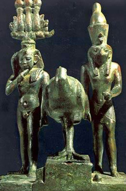 A bronze group with, on the left, the Child Horus wearing the Atef Crow