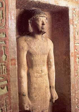 One of the statues of Idu in its niche on the west wall of his tomb