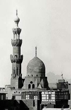 Note the simple dome on the mosque