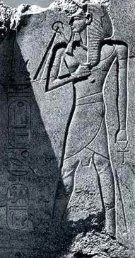 Ramesses II beneath the feat of the Colossus of Tuthmosis III