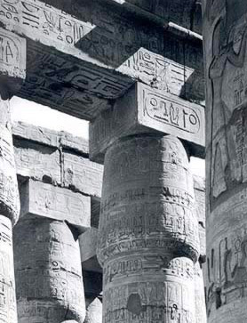 The first two north bays of the northwest group of monostyle columns. Note the cartouch of Ramesses II.