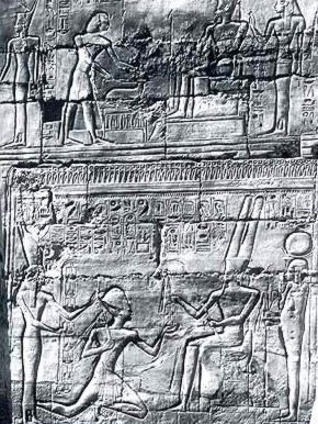 The king offering the oryx in the upper register, and kneeling before Amun in the lower register