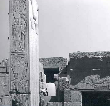 On the northern pillar, the king wears the red crown and is embraced first by hathor and then below by Amun