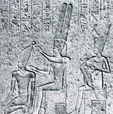Tuthmosis III with his back to Amun and behind this, the king depicted as a child receiving divine milk