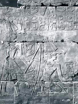 Tuthmosis III with a hoe and in the act of forming bricks fro the Temple Foundation