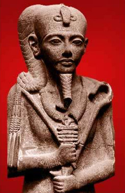 A black and red granite statue of Khonsu with the sidelocks of youth now in the Egyptian Museum