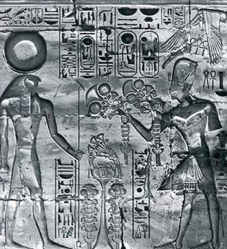 Ramesses IV offers the first fruits of the season to a falcon-headed Khonsu