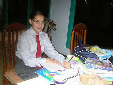 Dressed for school and doing homework
