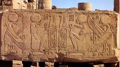The two primary deities of Kom Ombo, Sobek right and Haroeris, left, face each other on a block of sandstone