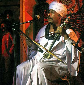 Playing the Rababa during the festival in Korba, Heliopolis