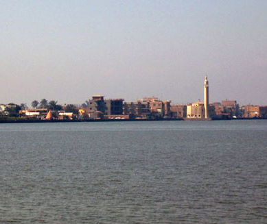 A modern village stretches along he shore of Lake Qarun
