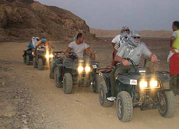 Moving along in line - Quad Biking near Marsa Alam