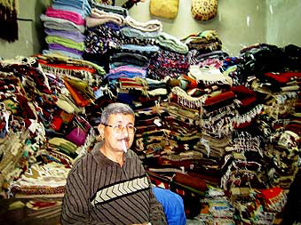 Mr Mamdouh in his carpet store