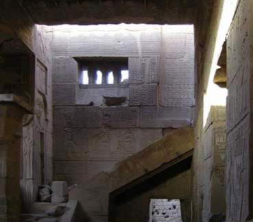 Inside the Hathor Temple, with a view of the stairway to the roof and the high window