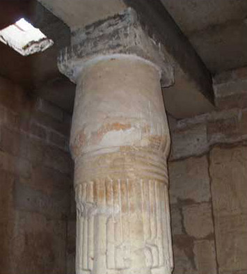 One of the ancient, Middle Kingdom columns within the portico