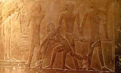 Limestone relief in the tomb of Idut at Saqqara, dating to the 6th Dynasty, showing a sled transporting a statue being dragged