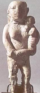 Predynastic statuette of a woman with a baby.