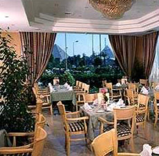 The Main Lobby Restaurant at the Movenpick Pyramids in Cairo, Egypt with a view of the Giza Pyramids