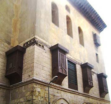 Facade of the Beshtak Palace with its mashrabeya windows