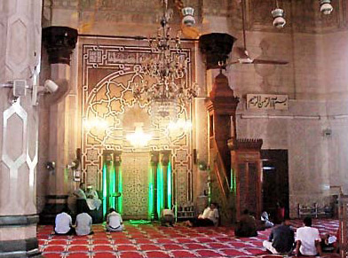 A view of the Qibla Wall. The nitch is the mihrab, with the minbar, a pulpti, to the right (facing the wall)