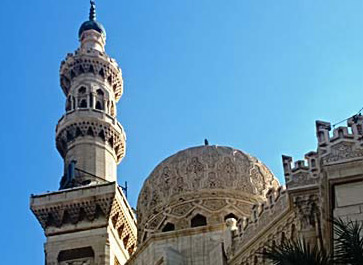A closer view of the minaret and one of the domes on the mosque