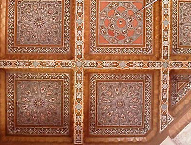 The ornate ceiling decorations within the main section of the mosque