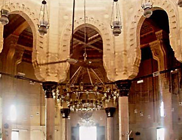A view of the columns and arches that support the ceiling in the mosque