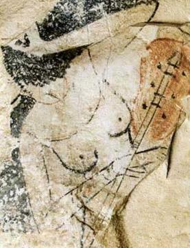 Ostracon from Deir   el-Medina showing a female lute player from an unusual prospective